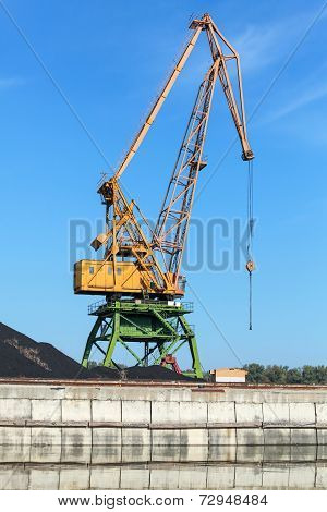 Big Industrial Harbor Crane Stands On The River Coast In Port