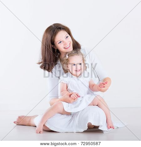 Beautiful Young Mother Playing With Hew Adorable Toddler Daughter