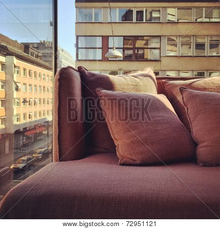 Purple Sofa In A Room With City View