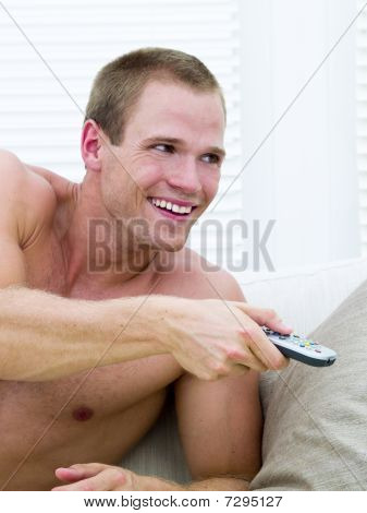 Muscular Man Watching Tv