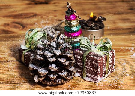 legacy glass Christmas toy on the background of pine cones