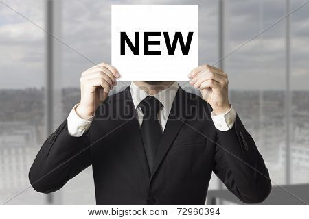 Businessman Hiding Face Behind Sign New