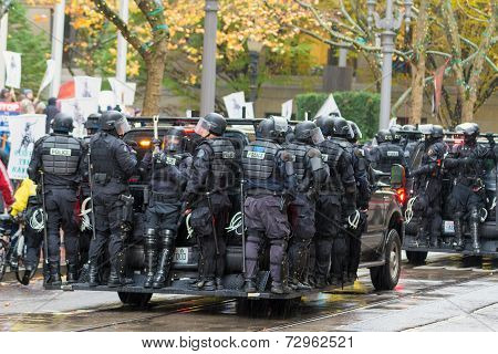 Riot Police On Vehicle To Control Occupy Portland Protest Crowd
