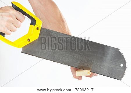 Hand of a joiner sawing a wooden block with a hacksaw on white background