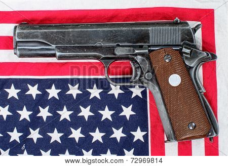 Gun Placed On An American Flag