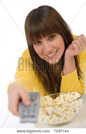 Smiling Female Teenager Watching Television