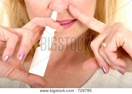 Spraying Nasal Spray In Nose