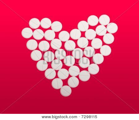 An Arrangement Of Little White Tablets Into A Heart, On White