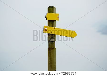 Directions sign post against blue sky, crossroad signpost, bright direction sign on beautiful sky ba