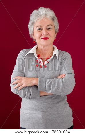 Senior woman posing with arms crossed