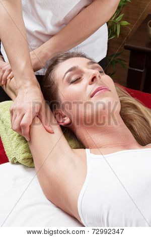 Hands of woman making massage a traditional thai spa.