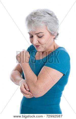 Senior woman touching her elbow itching her skin.