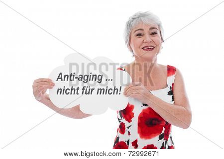 Senior woman holding Anti-aging is not for me sign