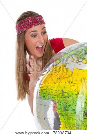 Young woman posing with globe