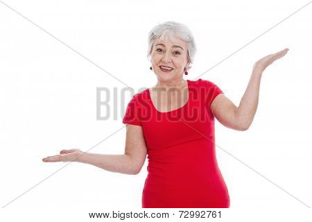 Senior woman explaining - making balance with her hands.