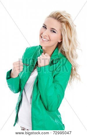 Studio shot of zestful young isolated woman in green.