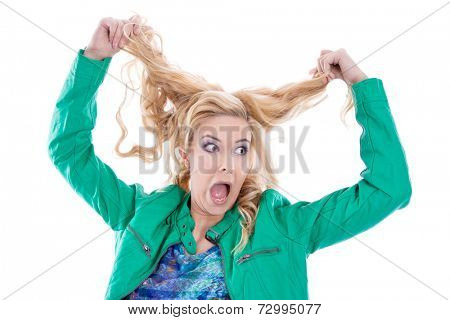 Annoyed woman tearing her hair