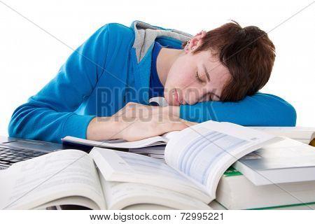 Caucasian teenager boy sleeping on table