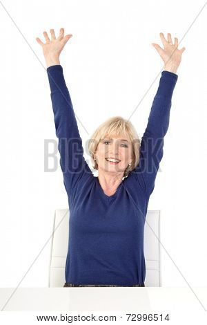 Happy senior woman sitting with raised arms, isolated on white background