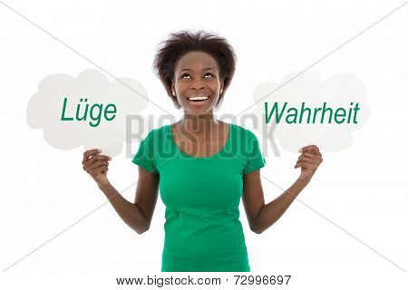 African American woman standing with two speech balloons, isolated over white background.