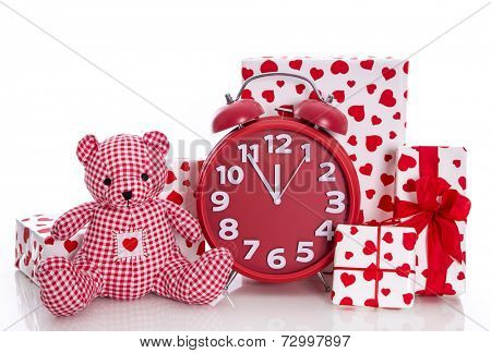 Christmas: red and white presents with clock and  pink teddy bear on white background - last minute shopping