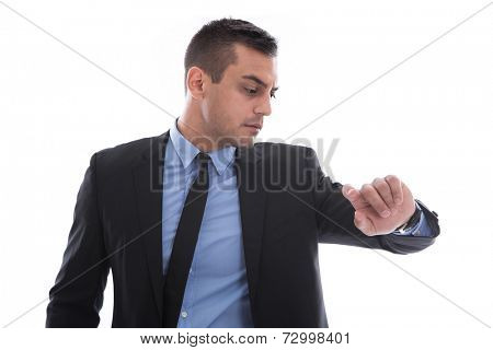 Business man looking at his watch. In a rush. Isolated on white background