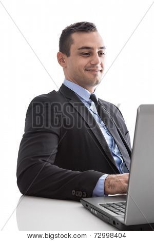 Young business man looking satisfied with laptop isolated on white background