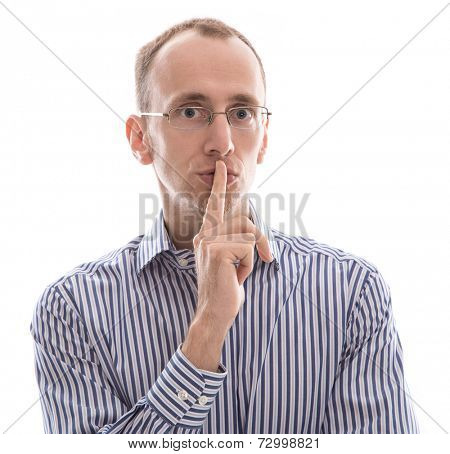 Man with glasses shushing - finger in front of mouth isolated on white background