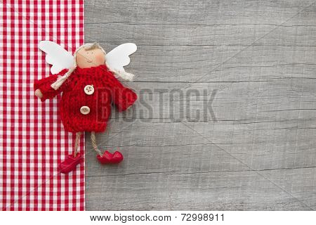 Red guardian or christmas angel in country style for a greeting card or gift card