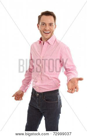 Successful attractive young man in pink with open hand gesture isolated on white background