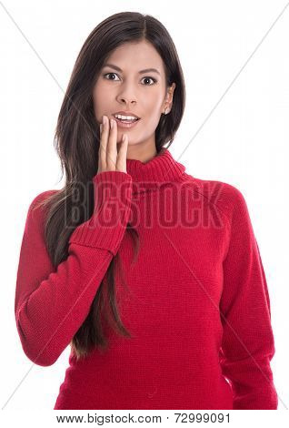 Shocked beautiful brunette in long red jumper isolated on white background