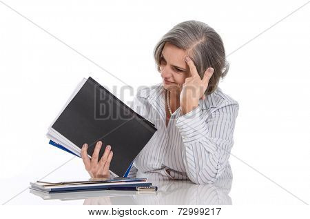 Overworked: grey haired woman stressed at work isolated on white background