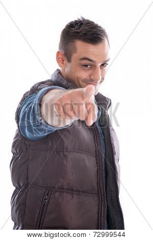 Cool man pointing at camera wearing blue denim shirt and puffer jacket isolated on white background