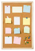 picture of bulletin board  - Blank sticky notes pinned on cork notice board - JPG