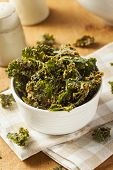 stock photo of kale  - Homemade Green Kale Chips with Vegan Cheese - JPG