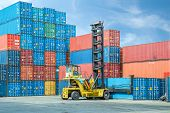 image of loading dock  - Crane lifter handling container box loading to depot - JPG