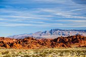 stock photo of valley fire  - big sky and red rocks in Valley of Fire State Park in Nevada - JPG