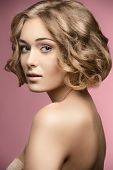stock photo of shoulders  - beautiful blonde woman posing with curly bob hair - JPG