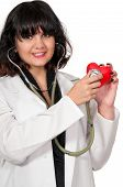 pic of open heart surgery  - Beautiful young woman cardiologist doctor holding a heart