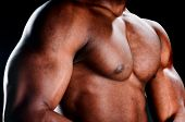 pic of body builder  - Close up of very muscular torso of an african american body builder - JPG