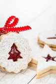image of linzer  - Christmas linzer cookies decorated with powdered sugar and with red jam center - JPG