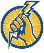 Hand holding lightning bolt of electricity