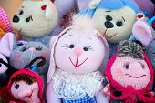 foto of rag-doll  - The souvenirs in the form of amusing dolls sewed from rags of fabric and laces - JPG