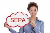 picture of bic  - Young woman looking at camera holding a SEPA sign isolated on white background - JPG