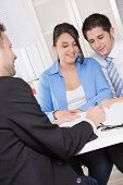 picture of rep  - Happy couple discussing future financial plans with consultant at office  - JPG