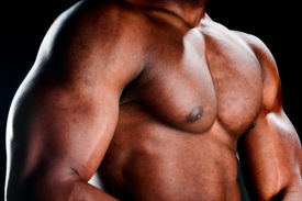 picture of body builder  - Close up of very muscular torso of an african american body builder - JPG