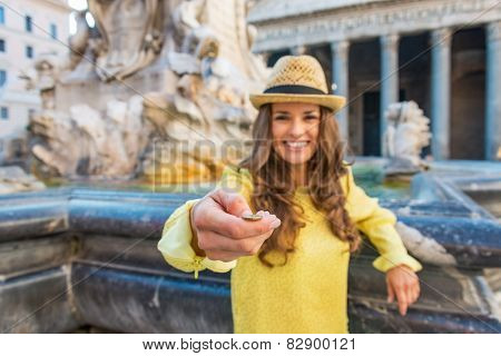 Closeup On Young Woman Tossing Coin Near Fountain Of The Pantheo