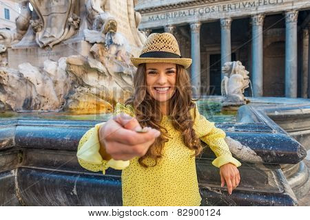 Young Woman Tossing Coin Near Fountain Of The Pantheon In Rome,