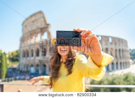 Closeup On Happy Young Woman Making Selfie In Front Of Colosseum