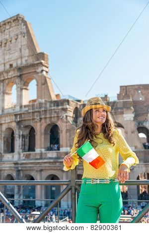 Happy Young Woman With Italian Flag In Front Of Colosseum In Rome, Italy